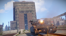 Screenshot of a Rust tank shooting at a fortress