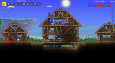 A screenshot of a Terraria community server with multiple small bases